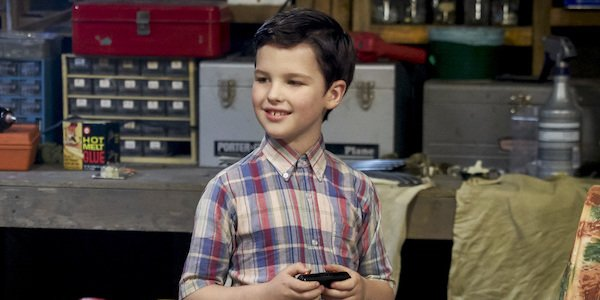 Young Sheldon with his train set