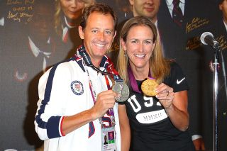 Coach Jim Miller and Kristin Armstrong given the Order of Ikkos medal at the USA House at the Royal College of Art in 2012