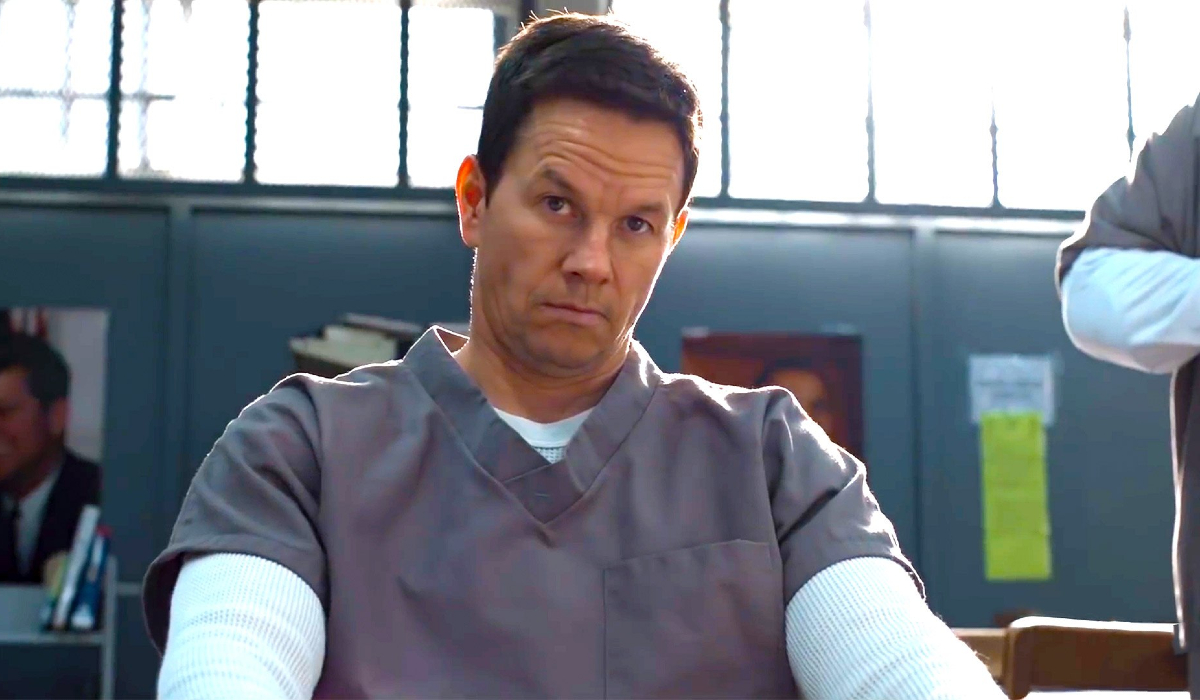 Spenser Confidential Mark Wahlberg sitting in prison, looking irritated