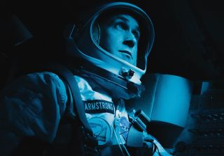 Ryan Gosling sits in the Apollo capsule