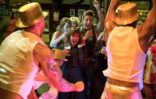 Pierce Harris hears Rhona Goskirk's name being chanted heads the the Woolpack, curious. He is taken aback to see Rhona dancing with one of the hunks. Unhappy Pierce heads away with his insecurities gnawing at him in Emmerdale