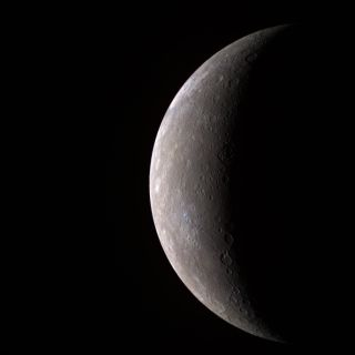 This visible-infrared image shows an incoming view of Mercury, about 80 minutes before Messenger's closest pass of the planet on Jan. 14, 2008, from a distance of about 27,000 kilometers (17,000 miles). The color image was generated by combining three sep