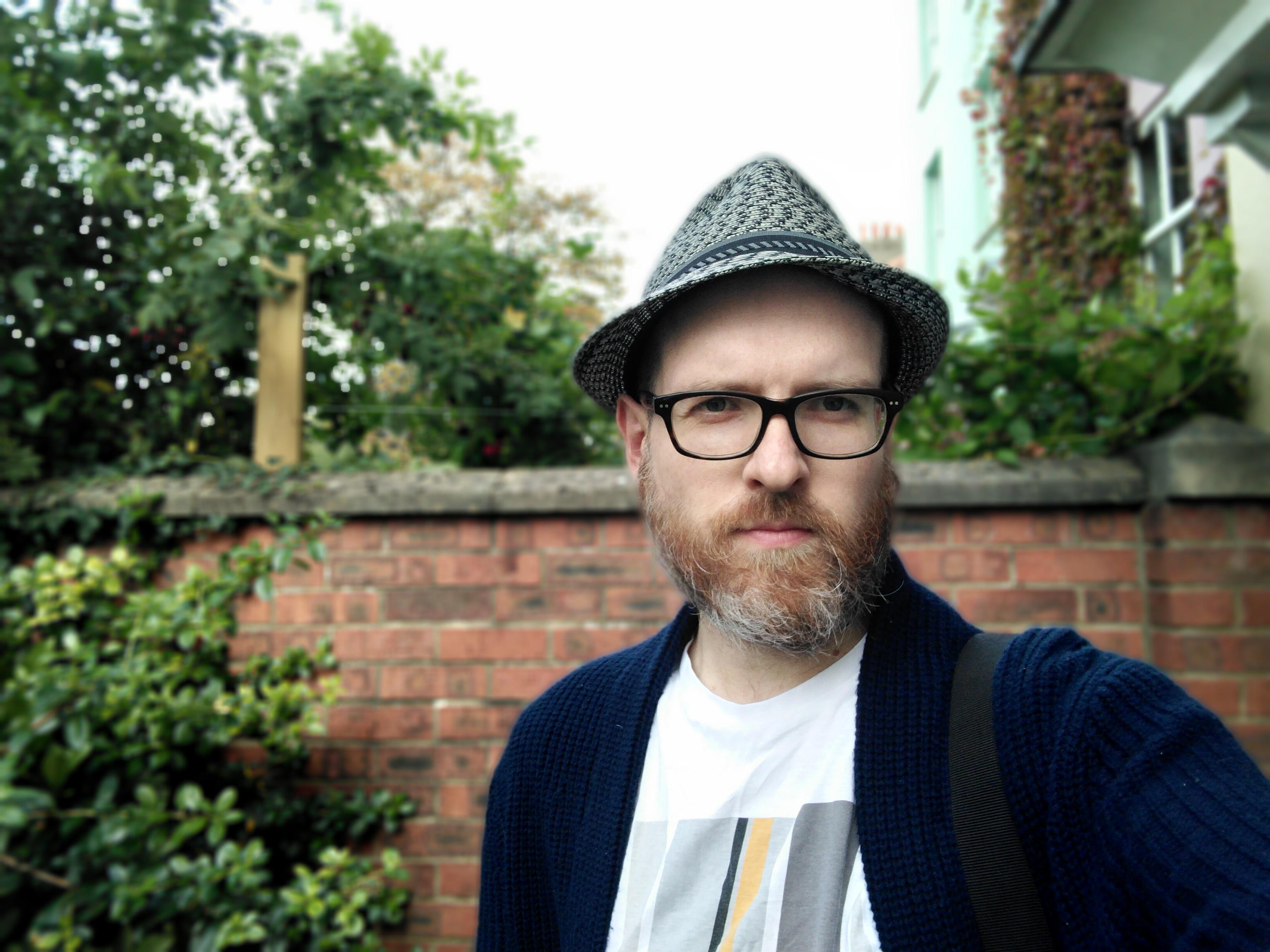 A photo of a man taken using portrait mode
