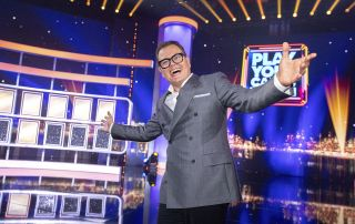Alan Carr hosting Play Your Cards Right for his Epic Gameshow.