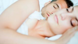Can dehumidifiers help with snoring? Image shows couple in bed