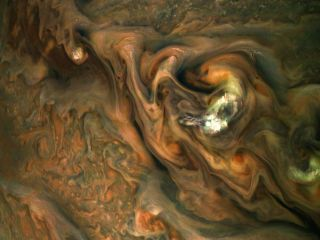 """In this image of Jupiter, you can see a jet stream region on the planet's upper hemisphere known as """"Jet N3."""" The region is rich with colorful, swirling patterns. This image was created by citizen scientist Gerald Eichstädt from a raw image taken on May 29, 2019."""