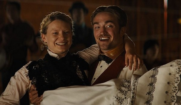 Damsel Mia Wasikowska Robert Pattinson all smiles with her in his arms