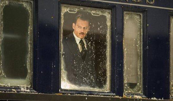 Ratchett's body in murder on the orient express found by Poirot