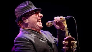 A photograph of Van Morrison on stage in 2015
