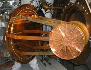 This large copper cylindrical vessel is the Enriched Xenon Observatory 200's (EXO-200) time projection chamber, the part of the detector that contains the liquid xenon, isotopically enriched in xenon-136. The photo shows the chamber being inserted into th