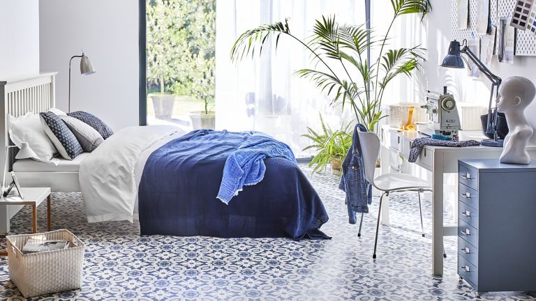 Blue and white bedroom with luxury vinyl tile by Carpetright