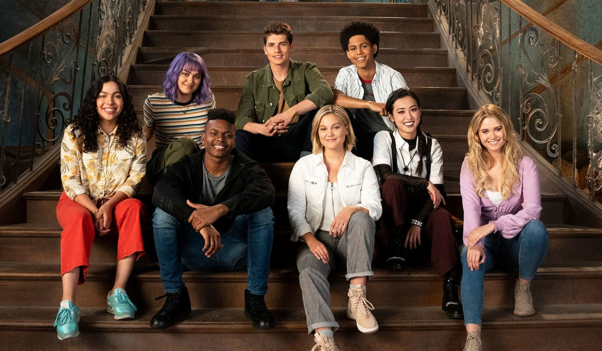 Marvel's Runaways the gang sits for a photo on some stairs