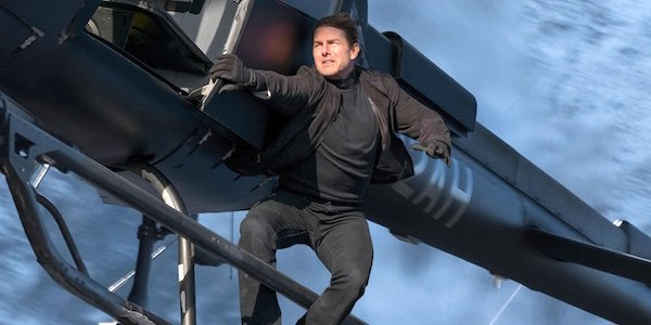 Tom Cruise as Ethan Hunt on helicopter in Mission: Impossible - Fallout