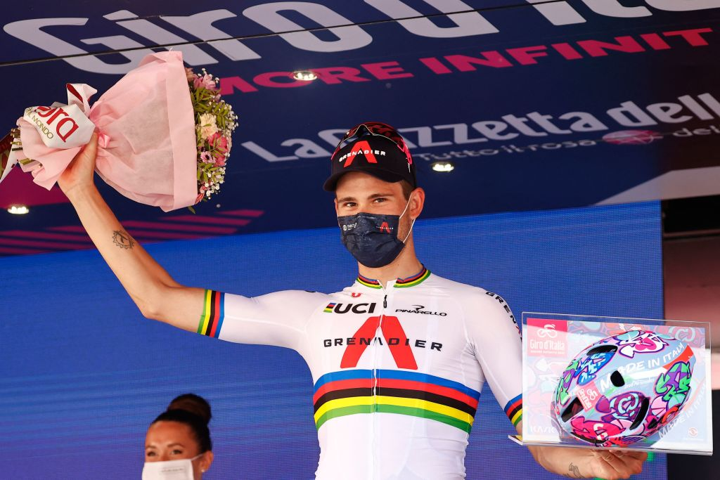 Team Ineos rider Italys Filippo Ganna celebrates on the podium after winning the 21st and last stage of the Giro dItalia 2021 cycling race a 303km individual time trial between Senago and Milan on May 30 2021 Photo by Luca Bettini AFP Photo by LUCA BETTINIAFP via Getty Images