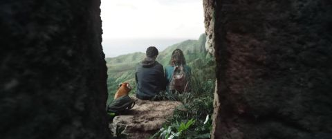 Will, Lyra, and Pan sit overlooking a beautiful gorge