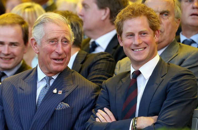 LONDON, ENGLAND - SEPTEMBER 10: Prince Charles, Prince of Wales and Prince Harry laugh during the Invictus Games Opening Ceremony on September 10, 2014 in London, England. The International sports event for 'wounded warriors', presented by Jaguar Land Rover, is just days away with limited last-minute tickets available at www.invictusgames.org (Photo by Chris Jackson/Getty Images)