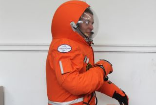 Final Frontier Design's Ted Southern kneels in the third version of his firm's private spacesuit. The spacesuit maker is based in Brooklyn, New York.