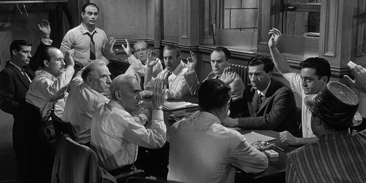 The room of jurors takes a vote  in 12 Angry Men