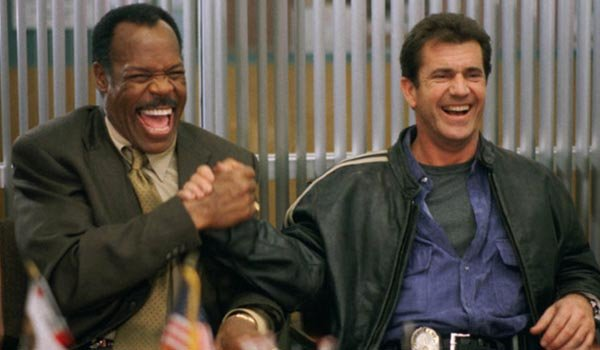 Danny Glover as Roger Murtaugh and Mel Gibson as Martin Riggs in Lethal Weapon