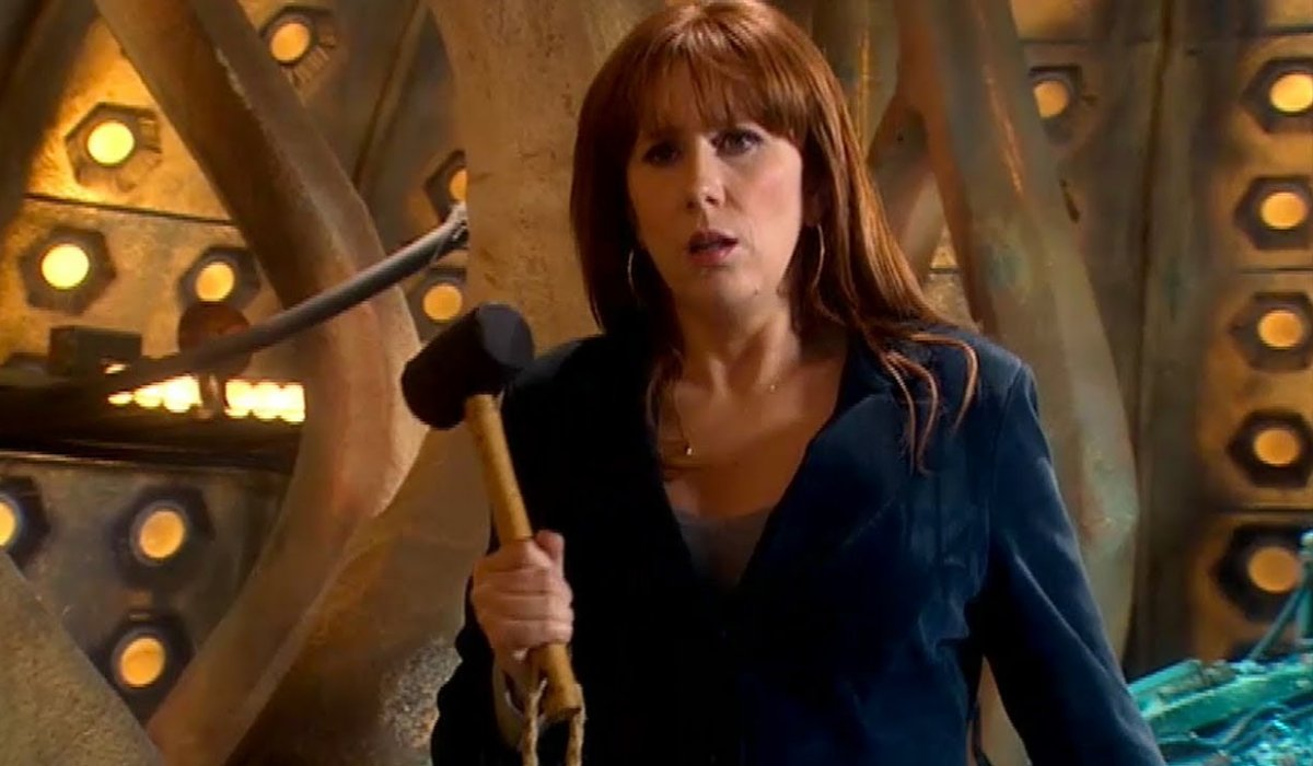 Doctor Who Donna Noble holding a rubber mallet in the TARDIS