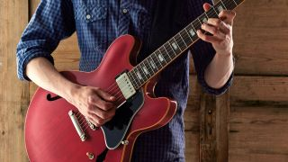 Man playing Gibson ES-335 electric guitar