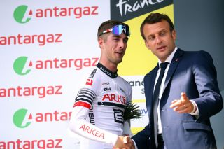 Elie Gesbert is congratulated by French president Emmanuel Macron after stage 14 of the 2019 Tour de France.