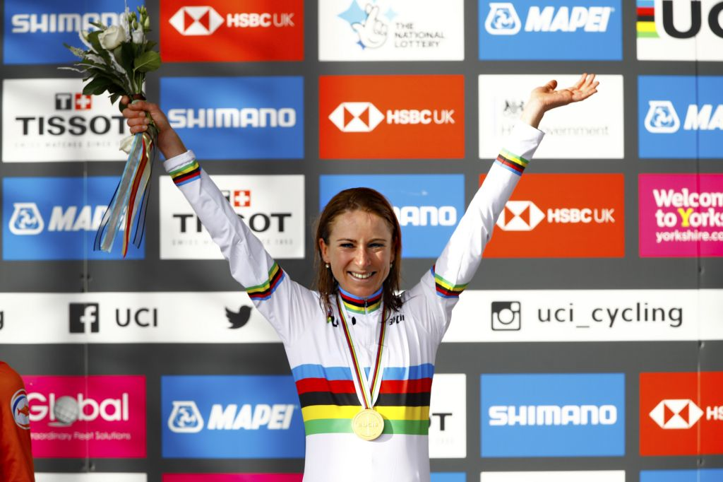Annemiek van Vleuten, of the Netherlands, takes the rainbow jersey after winning the elite women's road race at the 2020 UCI Road World Championships in Yorkshire