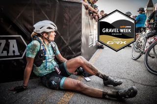 Alison Tetrick sits on the ground after finishing Dirty Kanza