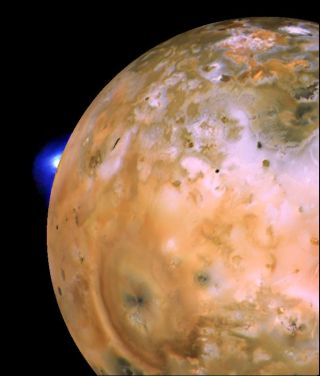 This image, captured by NASA's Voyager 1 spacecraft, shows a plume rising from Loki Patera, the largest volcano on the Jupiter moon Io.