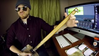 Rob Scallon playing a shovel