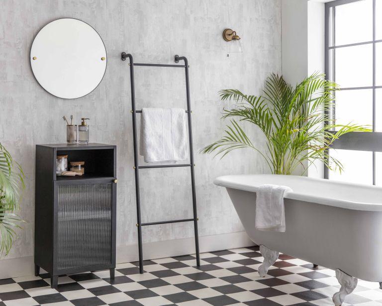 Bathroom cabinet ideas: Bathroom with wooden ladder, black bathroom cabinet and grey bathtub