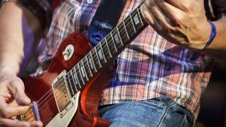 A musician playing guitar