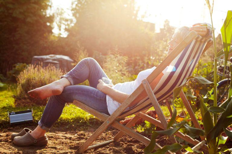 woman sitting in outdoor summer essentials