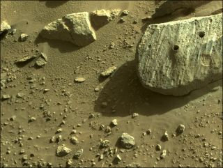 """NASA's Perseverance rover has collected two drilled-out samples from this Red Planet rock, which the mission team calls """"Rochette."""""""