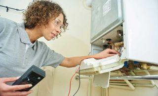 woman servicing a boiler