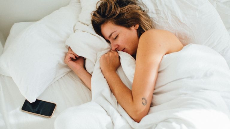 High Angle View Of Woman Sleeping On Bed - stock photo