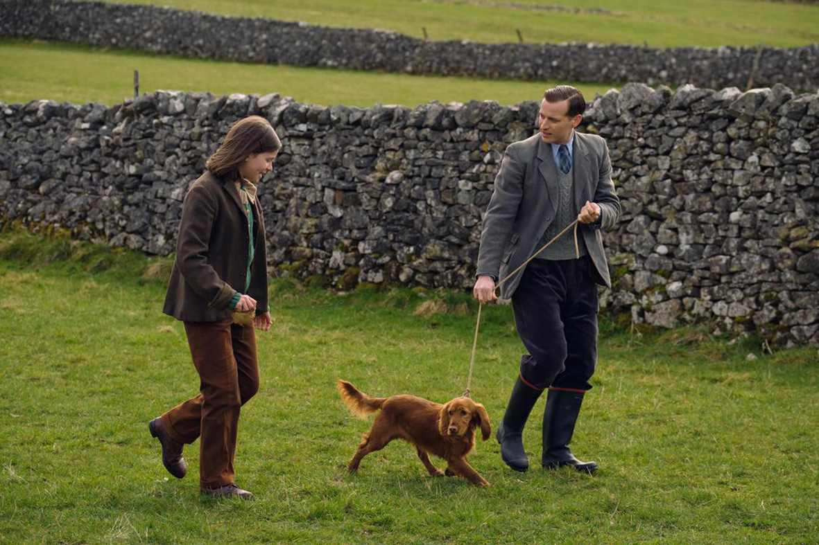 Jenny (Imogen Clawson) with James (Nicholas Ralph) and Scruff in All Creatures Great and Small