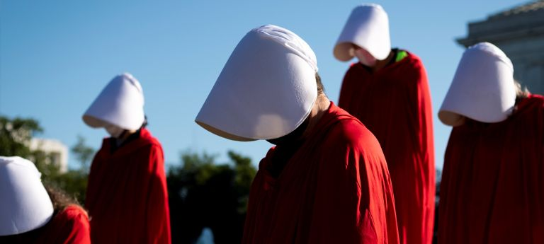 Demonstrators from the Center for Popular Democracy Action stand on the U.S. Supreme Court steps dressed in Handmaids Tale costumes to voice opposition to Judge Amy Coney Barretts nomination