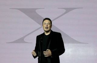 Elon Musk speaks during an event to launch the new Tesla Model X Crossover SUV in Fremont, California, on Sept. 29, 2015.