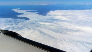 A broader view of the calving front of the Jakobshavn Glacier, as shown by a NASA research aircraft flying above them.