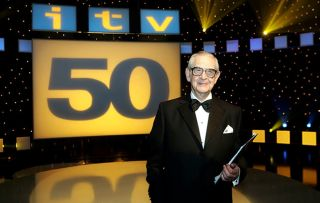 Denis Norden with his trademark clipboard which he used on It'll Be Alright On The Night