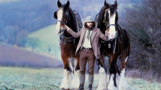 a photograph of ian anderson with two big horses