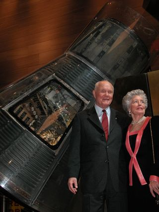 Former Senator John Glenn with his wife Annie as photographed standing next to Glenn's Mercury spacecraft, Friendship 7, at the National Air and Space Museum in Washington, DC on Feb. 20, 2002.