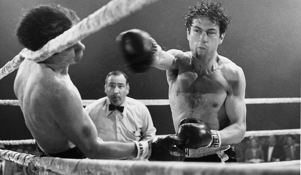 Raging Bull Robert DeNiro punches someone out in the ring