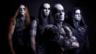A photograph of Behemoth taken in 2014, in full corpse paint and costumes
