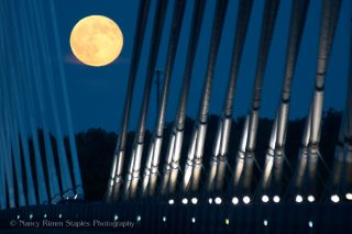 """The """"supermoon"""" full moon of July 12, 2014 is seen over Penobscot Narrows Bridge linking Prospect, Maine with Verona Island. Two more supermoon full moons will follow on Aug. 10 and Sept. 9."""