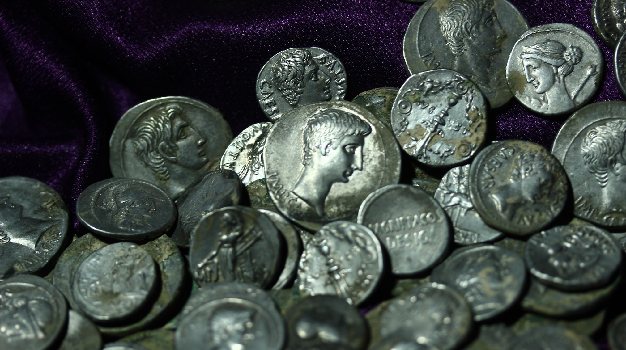 The coins featured Roman emperors on one side.