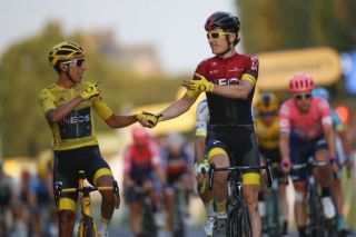 2019 Tour de France winner Egan Bernal and Team Ineos teammate Geraint Thomas – the 2018 winner – celebrate victory on the Champs-Elysées in Paris