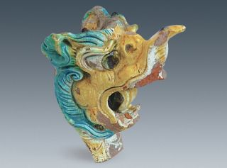 A colorful dragon head made of clay was found in a palace at Xanadu.