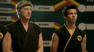 Johnny Lawrence (William Zabka) and Miguel Diaz (Xolo Maridueña) watch on in a competition.